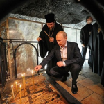 President Putin venerates the Stone of the Anointing