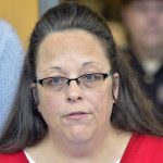 Rowan County Clerk Kim Davis makes a statement to the media at the front door of the Rowan County Judicial Center in Morehead, Ky., Monday, Sept. 14, 2015. Davis announced that her office will issue marriage licenses under order of a federal judge, but they will not have her name or office listed. (AP Photo/Timothy D. Easley)